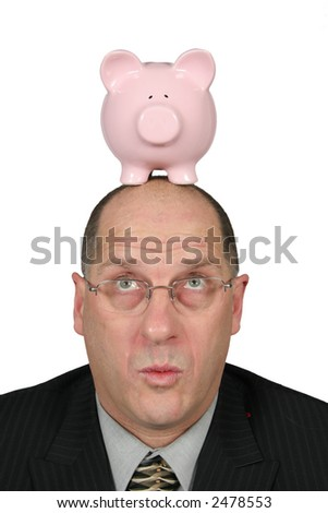 Business man with Piggy Bank on top of his head - stock photo