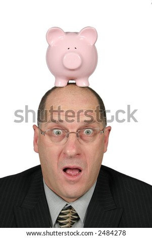 Business man with Piggy Bank on top of his head and mouth open - stock photo