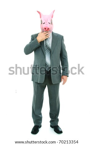 Business man with piggy mask closing his mouth - stock photo
