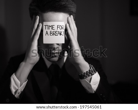 Business man with sign time for break on his forehead. - stock photo