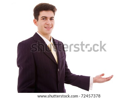 Business man with soft smile making presentation to copy space isolated on white background - stock photo