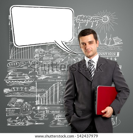 Business man with speech bubble, looking on camera - stock photo