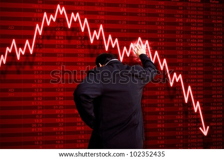 Business man with stock market disaster - stock photo