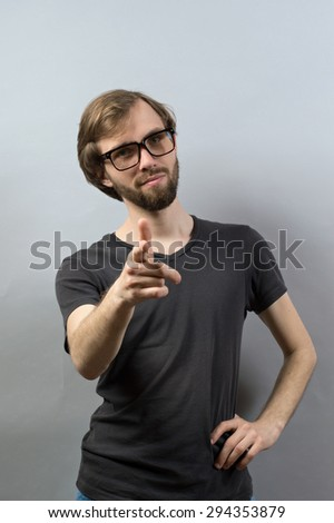 Business man with suit poiting finger at the camera acting as executive manager, boss or employer - stock photo