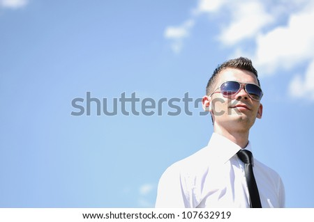Business man with sunglasses on sky