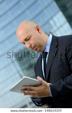 Business man with tablet - stock photo