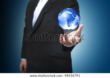 Business man with the digital globe ball floating on his hand. Concept for connectivity, communication within grasp.