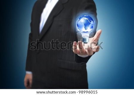 Business man with the digital globe ball floating on his hand. Concept for idea of connectivity within grasp.