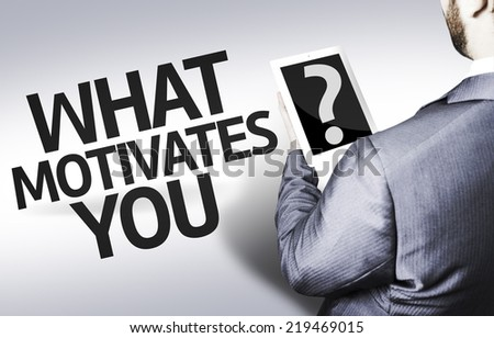Business man with the question What Motivates You? in a concept image - stock photo