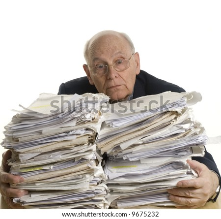 Business man with the table full of dossiers - stock photo