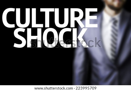 Business man with the text Culture Shock in a concept image - stock photo