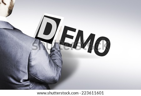 Business man with the text Demo in a concept image - stock photo