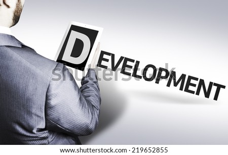 Business man with the text Development in a concept image - stock photo