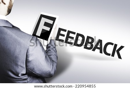 Business man with the text Feedback in a concept image - stock photo