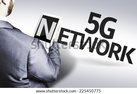 Business man with the text 5G Network in a concept image - stock photo