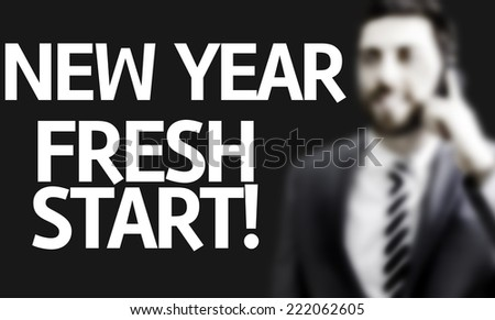 Business man with the text New Year Fresh Start in a concept image - stock photo