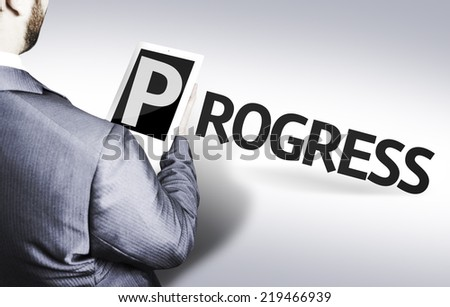 Business man with the text Progress in a concept image - stock photo