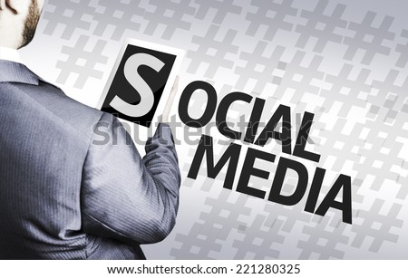 Business man with the text Social Media in a concept image - stock photo