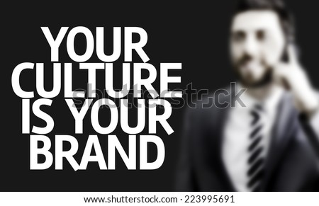 Business man with the text Your Culture is Your Brand in a concept image - stock photo