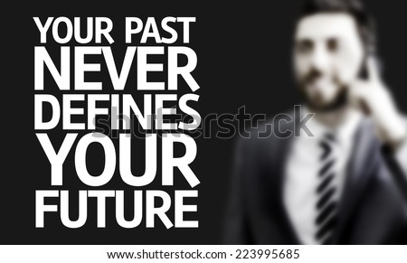 Business man with the text Your Past Never Defines Your Future in a concept image - stock photo