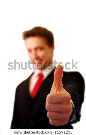 Business man with thumb lifted up !! - stock photo