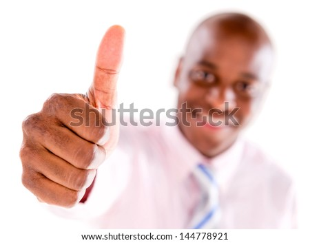 Business man with thumbs up - isolated over white background - stock photo