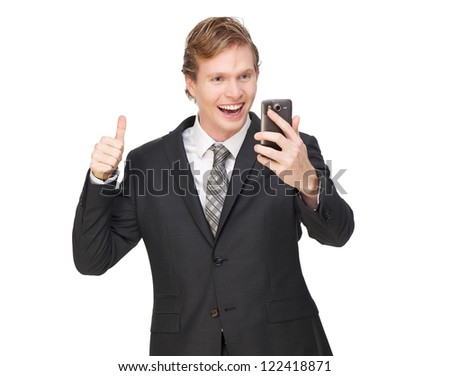Business man with thumbs up. Looking at phone and smiling. Isolated on white background - stock photo