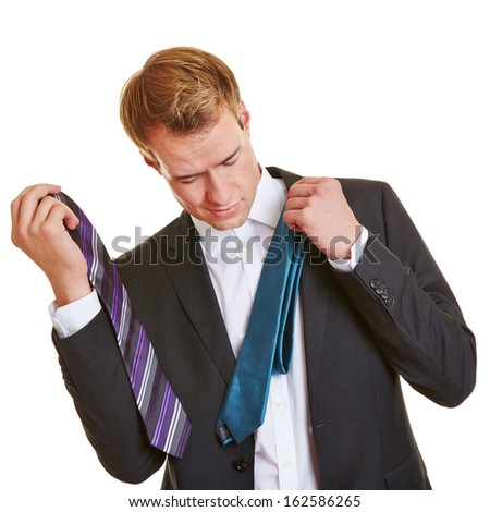 Business man with two ties in his hands choosing a tie for his suit