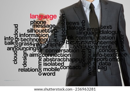 Business man with virtual interface of language wordcloud  - stock photo