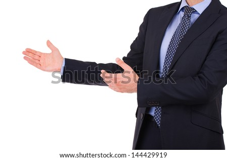 Business man with welcoming gesture. - stock photo