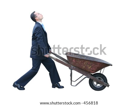 business man with wheelbarrow to collect something - stock photo