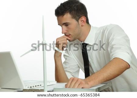Business Man with Windturbine - stock photo