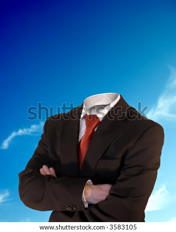 business man without a head in front of the perfect blue sky