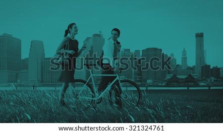 Business Man Woman Pushing Bike City Concept - stock photo