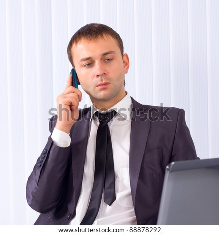 Business man working at office and calling on phone - stock photo