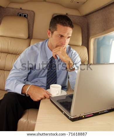 Business man working at private jet. - stock photo