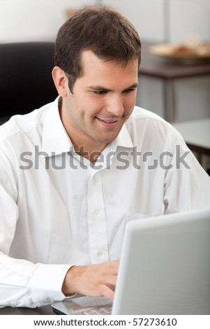 Business man working at the office with a laptop computer - stock photo