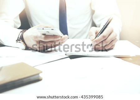 business man working,hand  phone  and  pen