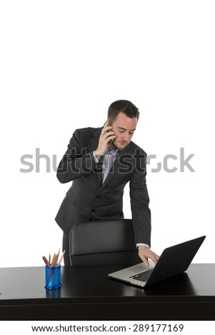 Business man working hard on his computer against a white background - stock photo