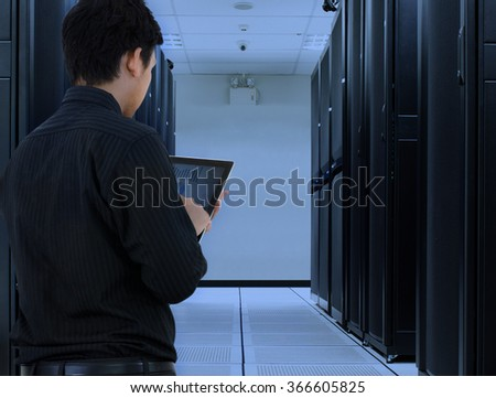 Business man working in data center with cloud technology - stock photo