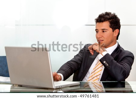 business man working on a laptop computer at the office - stock photo