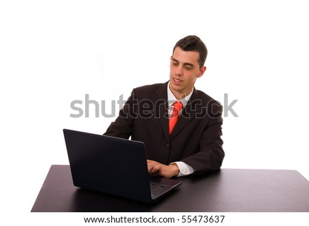 business man working on a laptop computer at the office