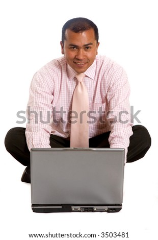 business man working on a  laptop computer - isolated over white