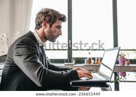 Business man working on computer desk - Busy office worker computing on lap top - stock photo