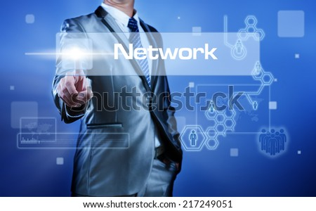 Business man working on digital virtual screen press on button network - stock photo