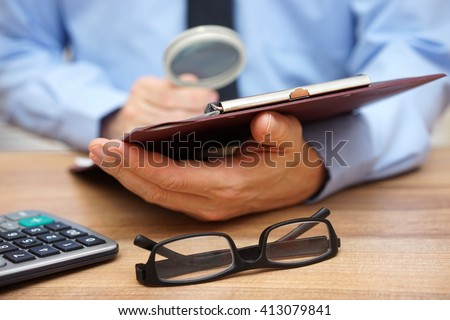 business man working on document focused and concentrated on terms and conditions - stock photo