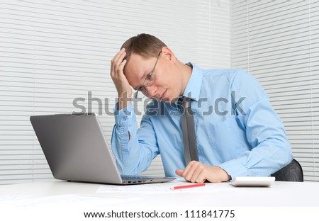 Business man working on his laptop computer - stock photo
