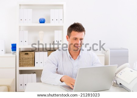 Business man working on laptop computer at home. - stock photo