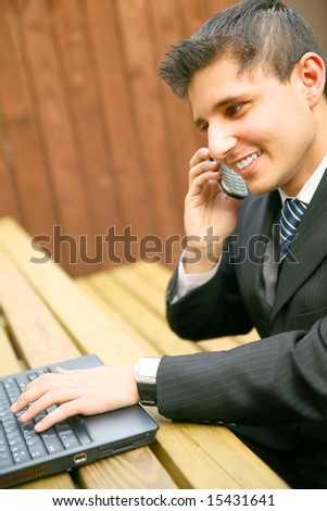 business man working outdoor, talking on the phone