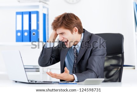 business man working problem using laptop looking at screen hold hands head, businessman sitting at the office desk, computer program virus or error concept